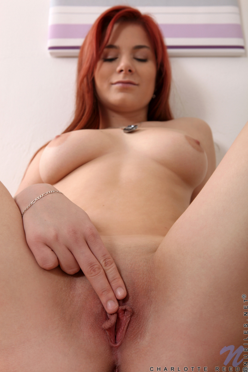 Redhead naked at computer and recording