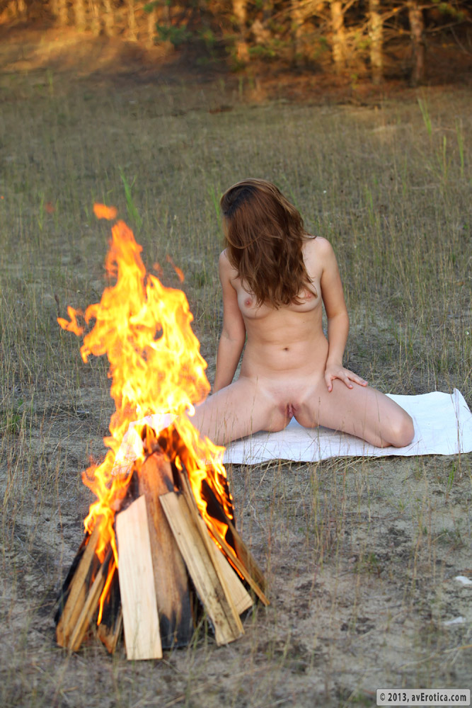 Campfire around nude sitting are