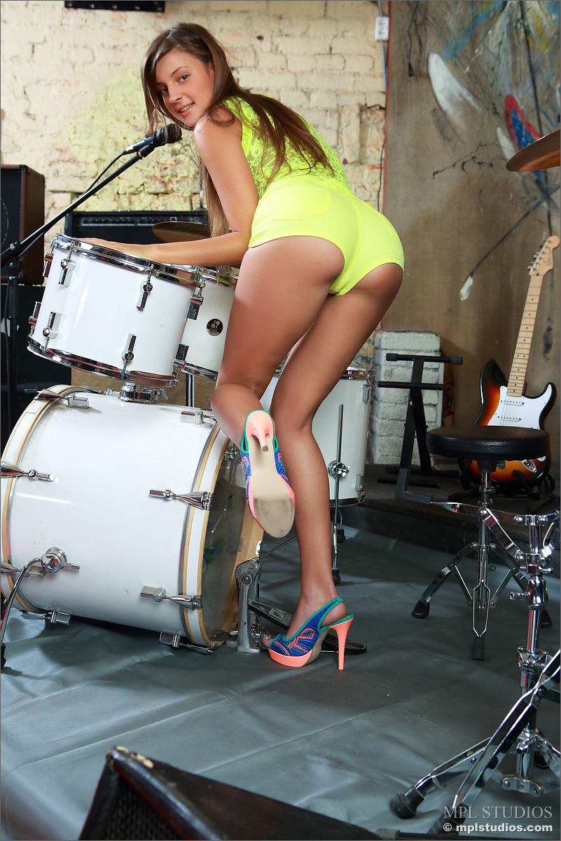 Naked girl playing drums — pic 5