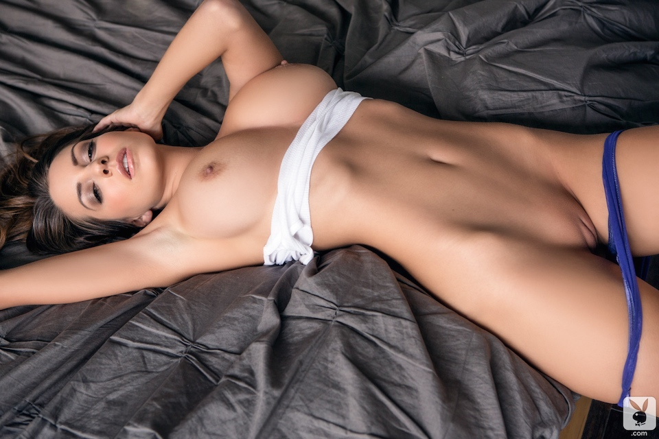 Chick poses totally naked in red couch 2